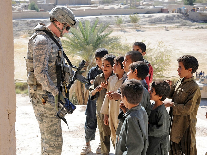 military taking with local children