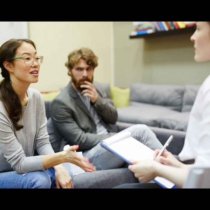 three people in a counseling session