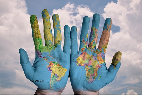 Visiting Scholars - hands with world map