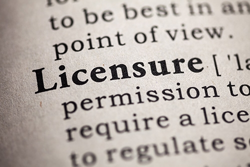 close up shot of dictionary with definition of licensure